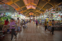 Ben Thanh Market is a large marketplace in District 1 of Saigon.  The market is one of the most recognizable structures in the city and one of symbols of Saigon or as it is officially known:  Ho Chi Minh City.  The market was set up by the French colonial government in 1912.   Ben Thanh Market is recognizable from its clock tower on the large traffic circle on the south side of the market.  There are several hundred small stalls stuffed with a huge array of goods though many items have no fixed price and vendors always quote higher prices to tourists.  Bargaining is a must.  If the great selection of goods inside Ben Thanh won't do, there's plenty to be had in the surrounding side street shops that is not officially Ben Thanh Market but considered to be so by local Vietnamese shoppers who presume that pricing inside Ben Thanh is aimed at overseas Vietnamese and tourists and consequently higher than Vietnamese normal prices.