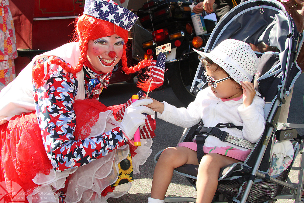 Qt Pat 2T female Shriner Clown, with child in stroller, Pacific Grove, California, Good Old Days Parade