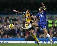 Photo: Lee Earle.<br /> Chelsea v Wigan Athletic. The Barclays Premiership.<br /> 10/12/2005. Chelsea's Arjen Robben (R) battles with Josip Skoko.