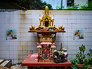 """18 JULY 2017 - BANGKOK, THAILAND: A """"Spirit House"""" at the end of Soi 27 off of Sathu Pradit in Bangkok. The area was a working class neighborhood of two storey shophouses. Most of the homes in the were occupied by Thais of Chinese heritage. The owner of the land sold the land to a developer who plans to build a condominium tower on the site. The residents left in early July and the shophouses will be torn down in coming weeks.       PHOTO BY JACK KURTZ"""