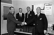 30/7/1964<br /> 7/30/1964<br /> 30 July 1964<br /> <br /> Mr L.A.C. Courtney the Maniging Director of Castrol (Ireland) on the Left Presenting Mr. Fred Youell with a Radiogram on his retirement as Deputy Chairman. Looking on is Mr. G.V. Collins (Director)second from the left and Mr John Harding(Sales Manager) Second from the right.