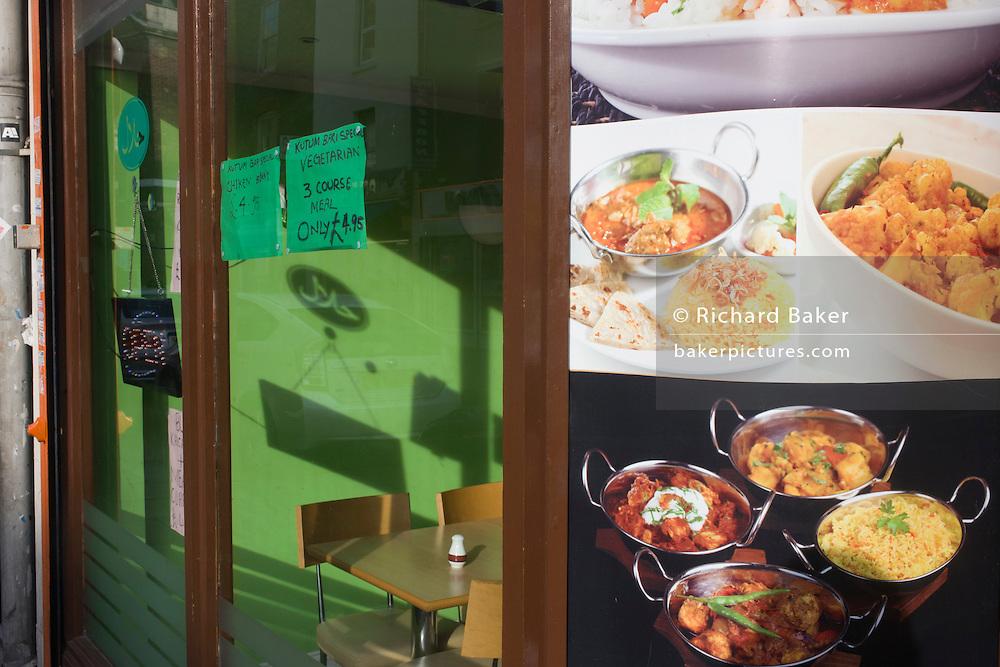 Vegetarian balti restaurant menu window.