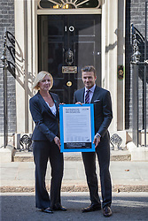 © Licensed to London News Pictures.FILE PICTURE FROM 26/07/2012. Westminster, UK. David Beckham in Downing Street with Anita Tiessen, the Deputy Executive Director of UNICEF, in his role as a Goodwill Ambassador for UNICEF. Recently published hacked e-mails, allegedly from David Beckham, reveal his thoughts on not receiving an honour from Queen Elizabeth II. Photo credit : Stephen Simpson/LNP