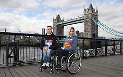 Winners of the men and women's 2018 Virgin Money London Marathon wheelchair race Great Britain's David Weir (left) and Australia's Madison de Rozario during a photocall outside Tower Bridge, London.