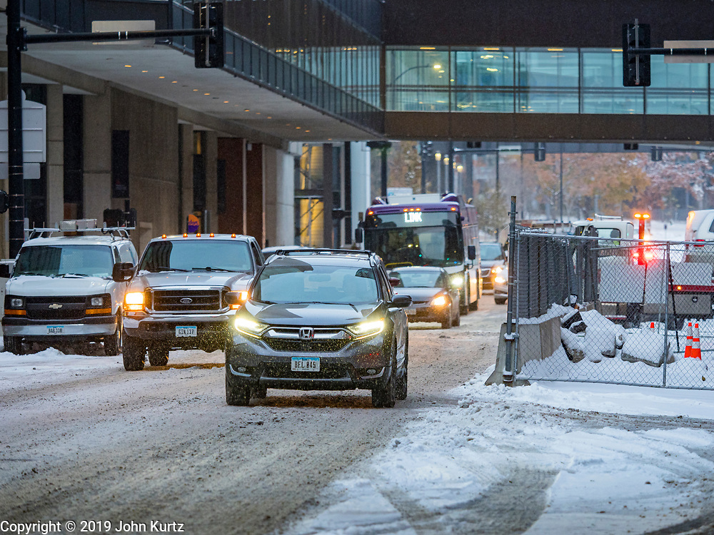 11 NOVEMBERS 2019 - DES MOINES, IOWA: Morning traffic on snow packed streets in downtown Des Moines Monday. About three inches of snow fell in the Des Moines area Sunday night into Monday morning snarling the Monday morning rush hour and delaying central Iowa schools by about two hours.        PHOTO BY JACK KURTZ