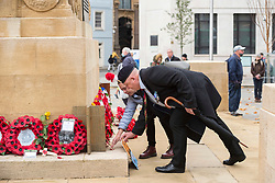 © Licensed to London News Pictures; 11/11/2020; Bristol, UK. Remembrance Day at the Bristol Cenotaph in the city centre. Corporal JOHN FOY attends the event. Corporal Foy was in the Royal Regiment of Fusiliers from 1978 to 1992. The normal large military parade and civic procession was cancelled due to the national lockdown restrictions for the Covid-19 coronavirus pandemic, but around 40 people gathered for the two-minute silence that traditionally takes place at 11.00am, recognising the precise time that the hostilities ceased in 1918 – the 11th hour of the 11th day of the 11th month. Photo credit: Simon Chapman/LNP.