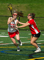 Laconia's Becca Howe charges down the field with pressure from Campbell's Jocelyn Theriault during NHIAA division III lacrosse on Wednesday afternoon.  (Karen Bobotas/for the Laconia Daily Sun)