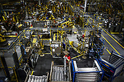 A Ford Kentucky Truck Plant worker prepares parts for automated assembly for the new Ford Super Duty.