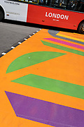 A Toots London tour bus drives over the multi-coloured markings of a crossing at Piccadilly Circus, on 16th July 2021, in London, England.