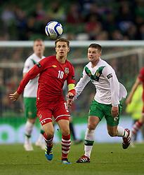 DUBLIN, REPUBLIC OF IRELAND - Friday, May 27, 2011: Wales' captain Aaron Ramsey and Northern Ireland's Robert Garrett during the Carling Nations Cup match at the Aviva Stadium (Lansdowne Road). (Photo by David Rawcliffe/Propaganda)