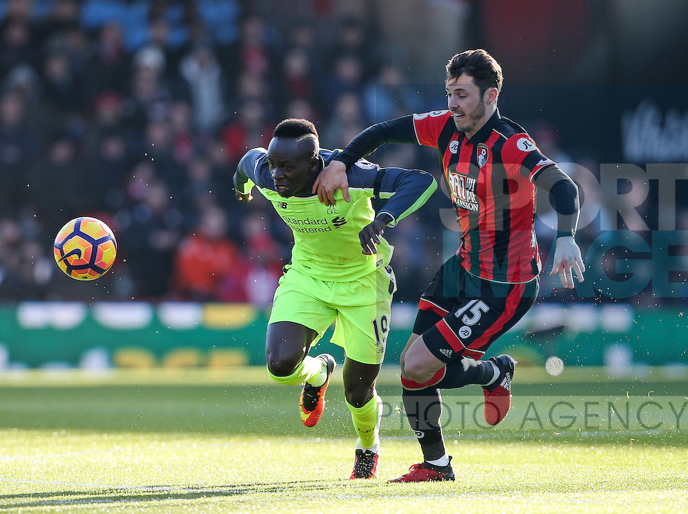 Bournemouth's Adam Smith tussles with Liverpool's Sadio Mane during the Premier League match at the Vitality Stadium, London. Picture date December 4th, 2016 Pic David Klein/Sportimage