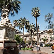 A statue fountain the center of in Plaza de Armas in Santiago de Chile.