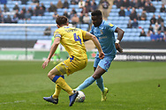 Coventry City forward (on loan from Wolverhampton Wanderers)Bright Enobakhare (24) looks to get the better of Coventry City defender Jordan Willis (4) during the EFL Sky Bet League 1 match between Coventry City and Bristol Rovers at the Ricoh Arena, Coventry, England on 7 April 2019.