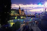 France. Paris. 4th district.  Urban beach on the Seine river quays. the conciergerie, sunset. summer time