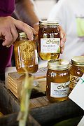 HOT SPRINGS, AR – JUNE 29, 2013: Al Dickson shows the honey he and his daughter sell each week at the local farmer's market.