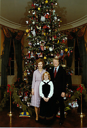 Dec. 30, 2010 - Washington, District of Columbia, United States of America - United States President Jimmy Carter, right, first lady Rosalynn Carter, left and Amy Carter, center, pose for a photo in front of the Christmas tree located in the Blue Room of the White House in Washington, D.C., on Tuesday, December 20, 1977..Mandatory Credit: Karl Schumacher - White House via CNP (Credit Image: © Karl Schumacher/CNP via ZUMA Wire)