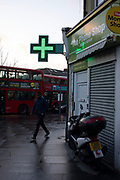 Street scene with chemists sign on a wet day in Leytonstone in East London, United Kingdom. Leytonstone is an area of East London, and part of the London Borough of Waltham Forest.