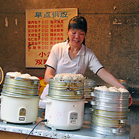 A street market vendor sells a variety of rice balls and dumplings in Chongqing, China.