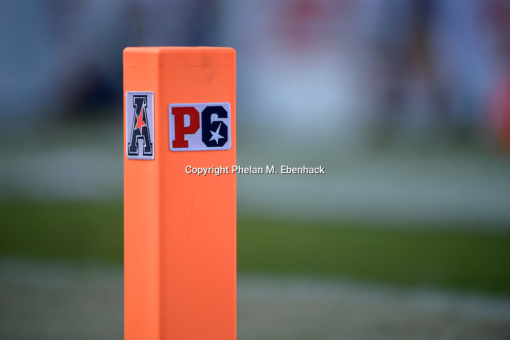A conference logo is affixed to an end zone pylon during the second half of the American Athletic Conference championship NCAA college football game between Central Florida and Memphis Saturday, Dec. 2, 2017, in Orlando, Fla. Central Florida won 62-55. (Photo by Phelan M. Ebenhack)