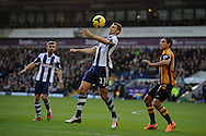 Gareth McAuley of West Brom © in action. Barclays Premier league, West Bromwich Albion v Hull city at the Hawthorns in West Bromwich, England on Saturday 21st Dec 2013. pic by Andrew Orchard, Andrew Orchard sports photography.