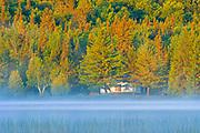 Cottage in morning fog on Lac des Sables<br />Belleterre<br />Quebec<br />Canada