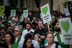 June 14, 2018 - London, United Kingdom - People seen holding several placards during the Grenfell Silent Walk as they arrive at the Kensington Memorial Park..On the first anniversary of the Grenfell Tower fire, which killed 72 people, the area around the tower has been filled with flowers, candles and messages to remember those who lost their lives. (Credit Image: © Brais G. Rouco/SOPA Images via ZUMA Wire)