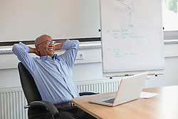 African businessman relaxed office working