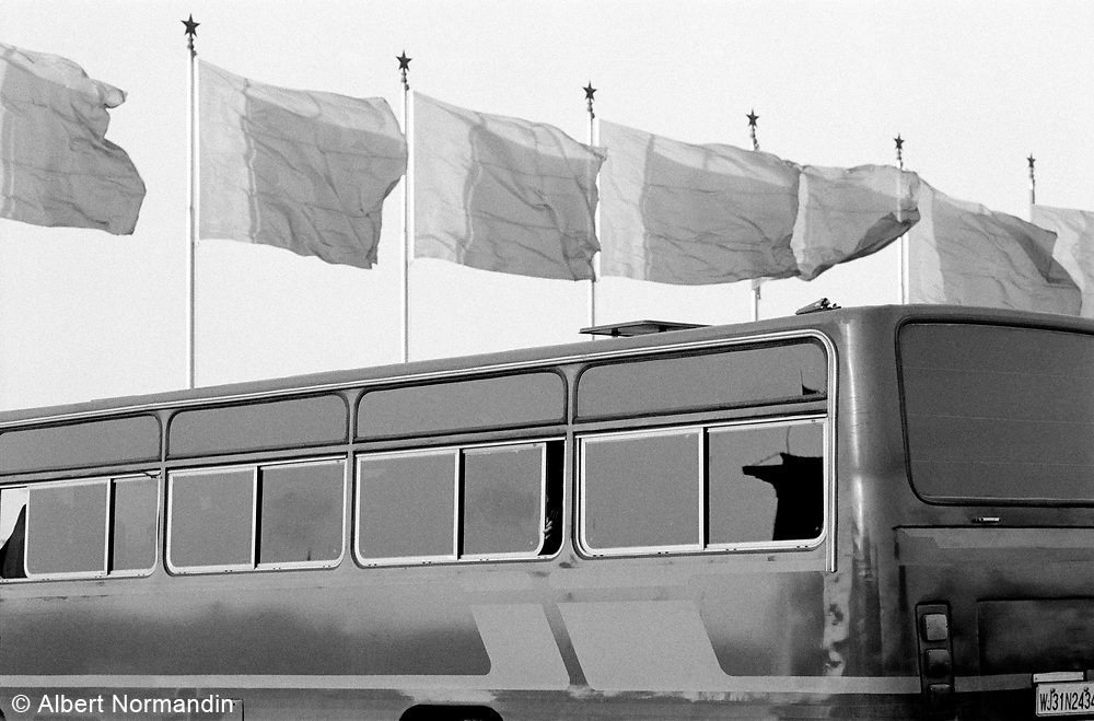 Military bus with flags flying