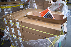 """© Licensed to London News Pictures . 04/12/2019. Manchester , UK . Pallets of stock of Amazon Fire HD10 tables inside the """"MAN1"""" Amazon fulfilment centre warehouse at Manchester Airport in the North West of England . Photo credit : Joel Goodman/LNP"""