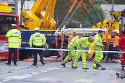 ©Licensed to London News Pictures 01/11/2019.<br /> Orpington,UK.Workmen cleaning the road. One person is dead and 15 others have been injured in a crash between two buses and a car last night in Orpington, South East London. A man has been arrested for dangerous driving. Police are still on scene and a cordon is in place. Photo credit: Grant Falvey/LNP