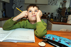 8 year old boy doing his homework UK