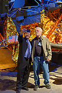 Garden City, New York, USA. May 23, 2019. At left, ANDREW CHAIKIN, author of A Man on the Moon: The Voyages of the Apollo Astronauts, takes a selfie with ALAN CONTESSA, who worked on the Apollo 11 lunar module, as they stand in front of the genuine Lunar Module LM-13, built for cancelled Apollo 18 mission. Working for Grumman, Contessa installed the gold silver foil, the thermal insulation that covers much of each LM. At the Cradle of Aviation Museum event, part of the celebration of the 50th Anniversary of Apollo 11, Chaikin talked about growing up on Long Island during the Apollo space program, and interviewing Apollo astronauts.