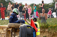 A competitor's wife/girlfriend/sister/etc looks relieved as he gets out of his rolled car unharmed during the race meeting at Smallfield Raceway, Surrey, UK on the 10th of July 2011 (photo by Andrew Tobin/SLIK images)