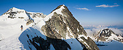 Climber Jim Prager ascends the NE Arete of Wedge Mountain (far left) in Garibaldi Provincial Park, British Columbia, Canada. Wedge (2800m) is the highest summit in the park.