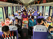 A staff comes to offer drinks (green tea, peach tea, beers etc) and food (instant noodles, packaged sausage etc), fuits etc. Life in the seating wagons in the train from Hong Kong to Urumqi, Xinjiang.