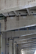 Express way overpass supports above a small river in Tokyo, Japan. Sunday August 24th 2014