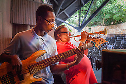 Bassist and Charlotte Amalie High School student Uriel Rogers plays alongside Arturo Sandoval.  Cuban Jazz trumpeter, pianist, and composer Arturo Sandoval plays alongside local high school and college musicians and answers questions about his life, inspiration, and performances at Reichhold Center for the Arts.  St. Thomas, USVI.  2 October 2015.  © Aisha-Zakiya Boyd