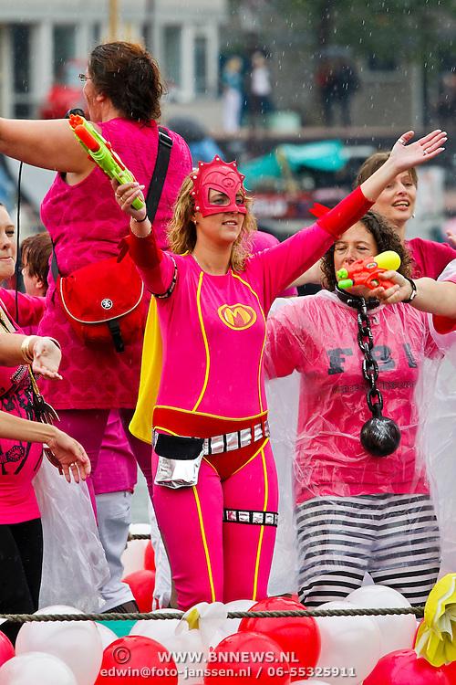 NLD/Amsterdam/20100807 - Boten tijdens de Canal Parade 2010 door de Amsterdamse grachten. De jaarlijkse boottocht sluit traditiegetrouw de Gay Pride af. Thema van de botenparade was dit jaar Celebrate, Mega Mindy