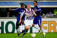 Fotball<br /> Nederland / Holland<br /> Foto: ProShots/Digitalsport<br /> NORWAY ONLY<br /> <br /> seizoen 2008 / 2009 05-10-2008 heerenveen - ajax 5-2 christian grindheim tussen jeffrey sarpong en urby emanuelson