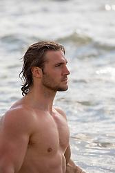 hot shirtless muscular man at a lake