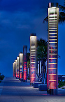 Lanters iluminating path to the beach at night in South Pointe Park, Miami Beach.