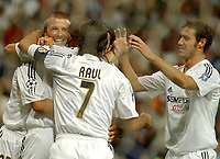 Fotball, 25. august 2004,  Real Madrid - Wisla Cracow, UEFA Champion's League previuous phase<br /> Real Madrid players David Beckham, Raul Gonzalez and Ivan Helguera congratulate Ronaldo (hidden)