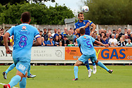 AFC Wimbledon striker James Hanson (18) winning header during the EFL Sky Bet League 1 match between AFC Wimbledon and Coventry City at the Cherry Red Records Stadium, Kingston, England on 11 August 2018.