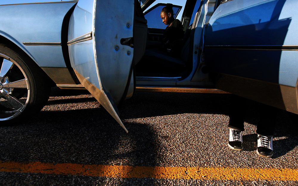 Music pours out of Lateek Townsend's car in the Marlboro County High School parking lot, as his girlfriend, Courtney Burroughs, 17, left, and cousin, Malik Townsend, 13, wait for a ride home after school.