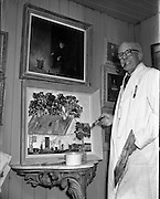 A. J. Cashen with painting at 17 South Anne St..24/09/1957