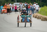 "Lauren Donahue drives her ""motor bike"" during the 2nd annual Franklin Elks Soap Box Derby Saturday morning.  (Karen Bobotas/for the Laconia Daily Sun)"