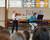 9 year old Benjamin Halford of Charleston, SC and Kay Wheeler perform La Cinquantaine for the Boys and Girls Club of the Lakes Region Thursday afternoon.  (Karen Bobotas/for the Laconia Daily Sun)
