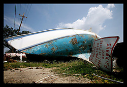 1 June, 2006. Lakeview, New Orleans, Louisiana. The first day of hurricane season 2006. Boats smashed by hurricane Katrina lie smashed in and out of the water at the New Orleans Marina, continuing to pollute the water and potentially provide debris problems in the event of a hurricane this season.