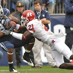 Oct 31, 2009; East Hartford, CT, USA; Rutgers cornerback Devin Mccourty (21) breaks up a catch attempt by Connecticut wide receiver Isiah Moore (83) during second half Big East NCAA football action in Rutgers' 28-24 victory over Connecticut at Rentschler Field.