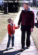 Active Aging Senior Citizens, Retired, Activities, Grandfather and Grandson Activities, Loving Relationship, Walking with Grandson, Suburban Sidewalk